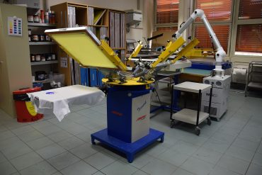 Industrial Screen Printing Machine Printing On T-Shirt In Miami